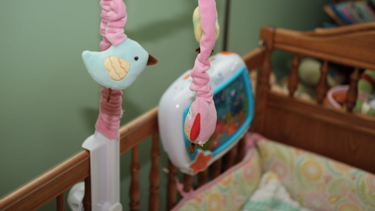 baby crib with mobile and soother
