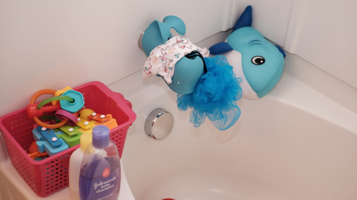 shark with whale and other toys in bathtub