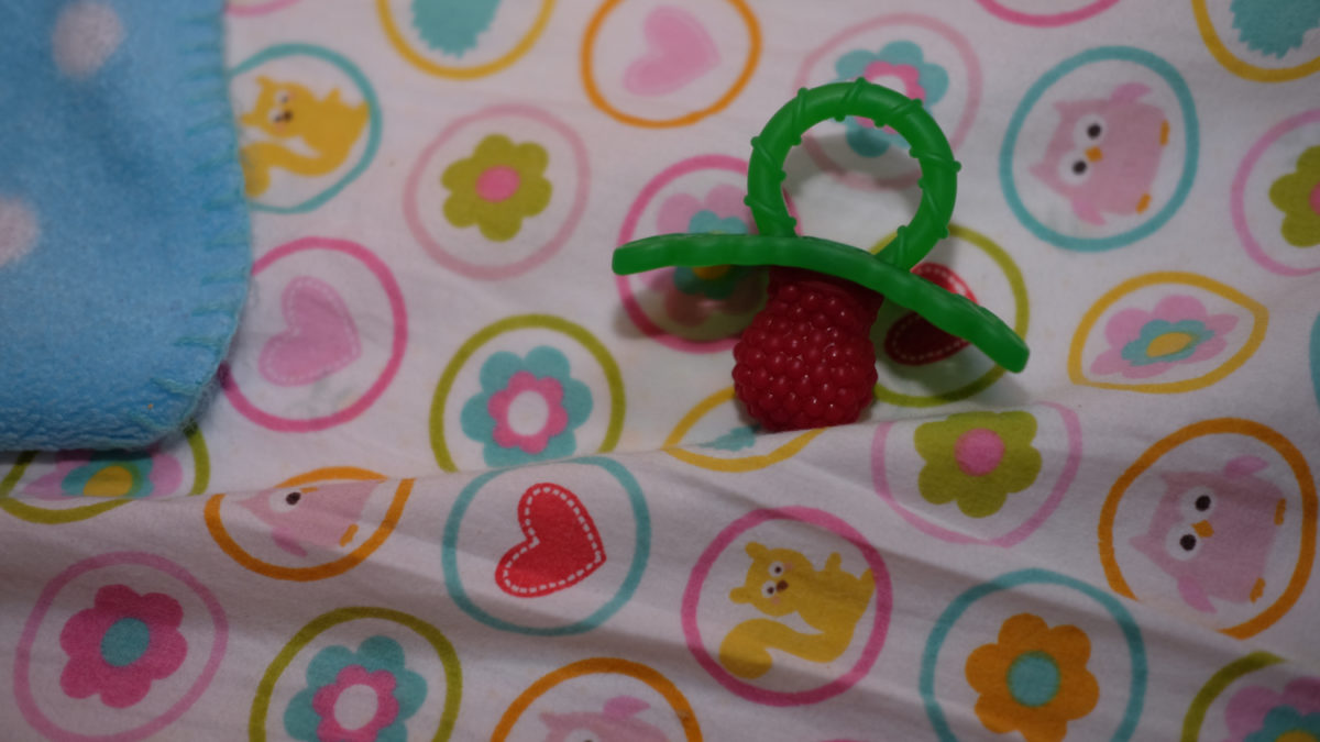 raspberry teether on sheet